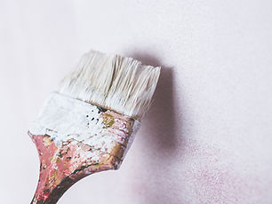 Image of a paintbrush in white paint