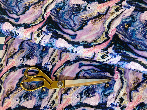 Purple gold and pink marbled fabric