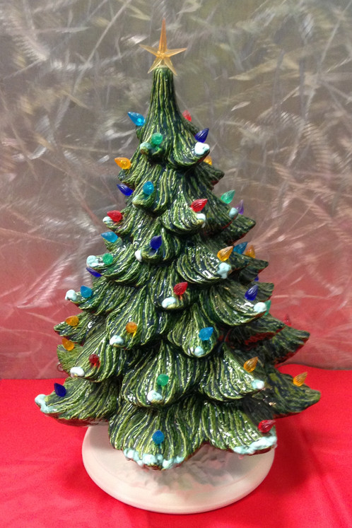 classic christmas tree with light kit measures 16 height includes tree base light bulbs and click light kit purchase includes tree being painted in