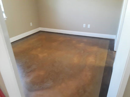 Natural concrete, stained and sealed with a high gloss sealer