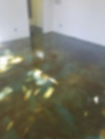 Acid stained concrete. Green and brown