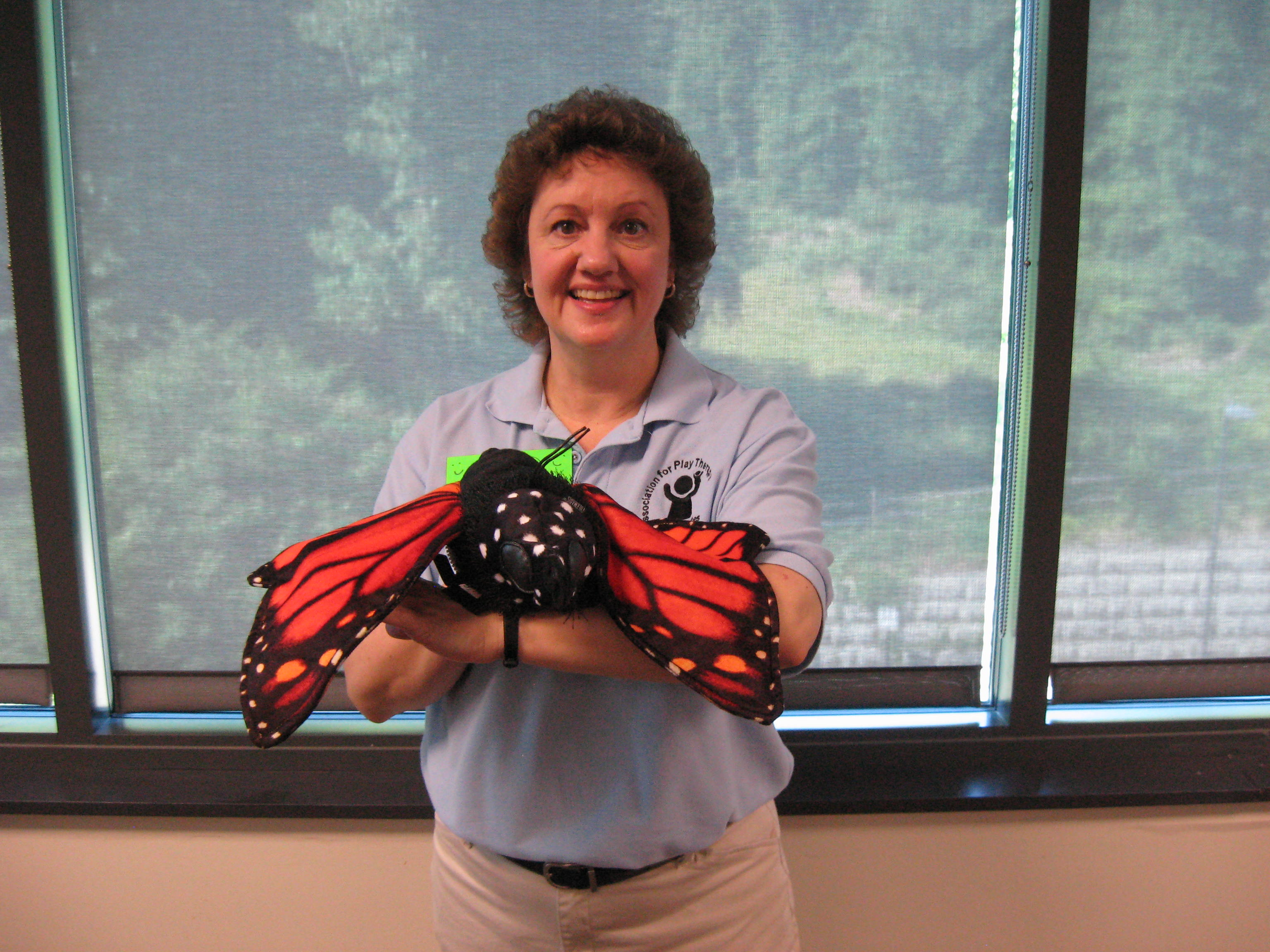 Jacque loves the butterfly puppet!