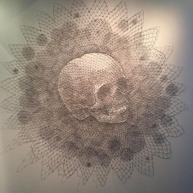 Walter Oltmann's _Skull Child_ of 2013 is weirdly beautiful made of bent wire to replicate lace