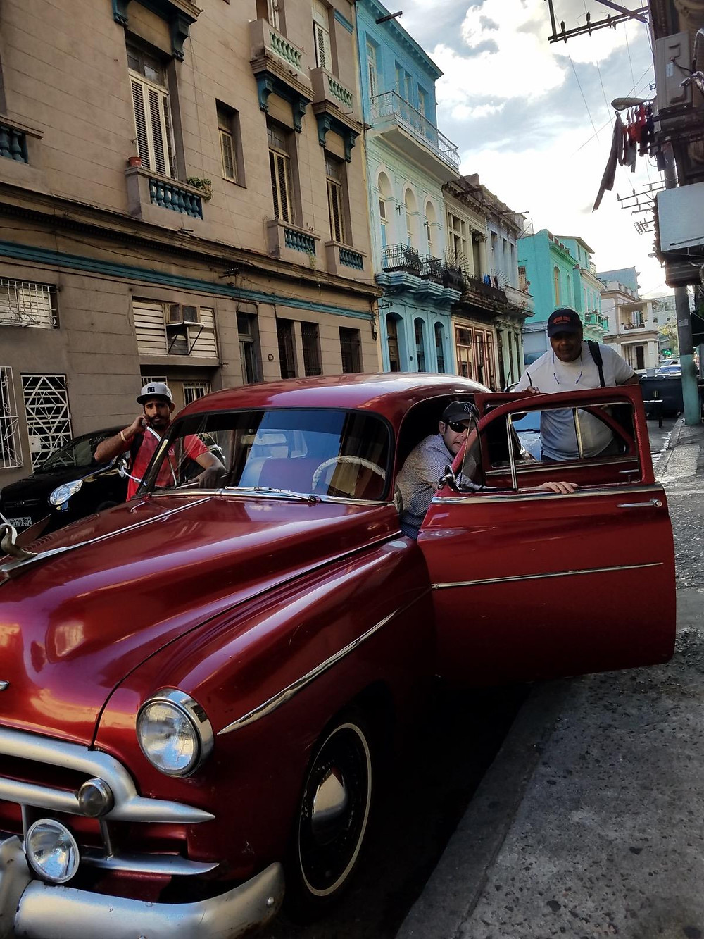 Guests enjoying a ride during a Cuba Trip in classic CHevy