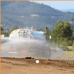 Water truck picture - spraying.PNG