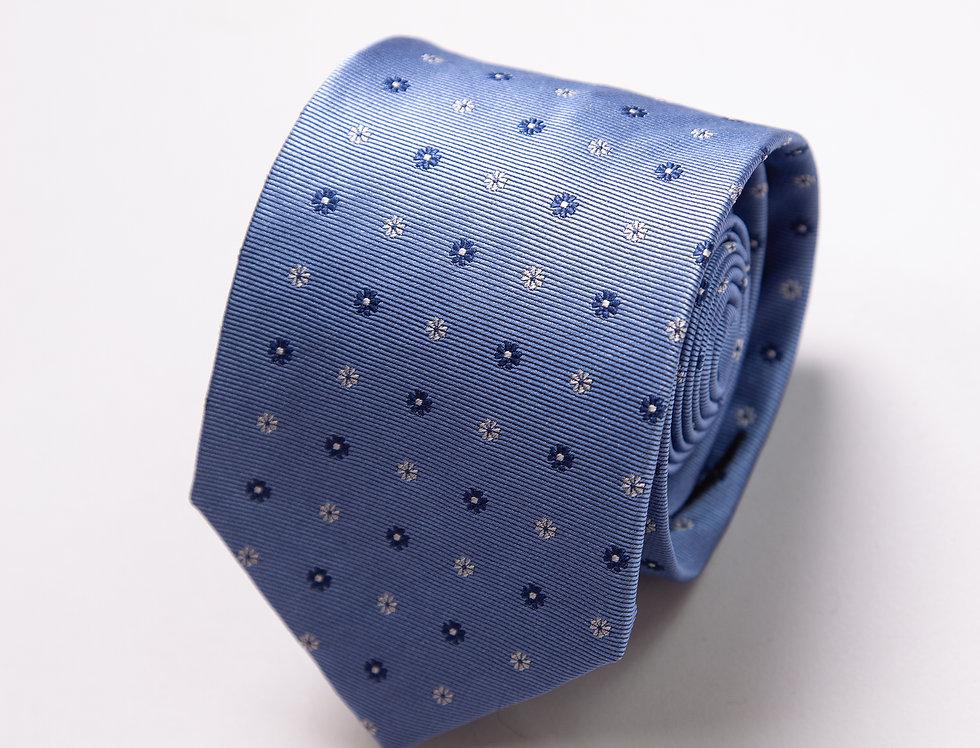 Cravatta pura seta celeste con piccoli fiori blu
