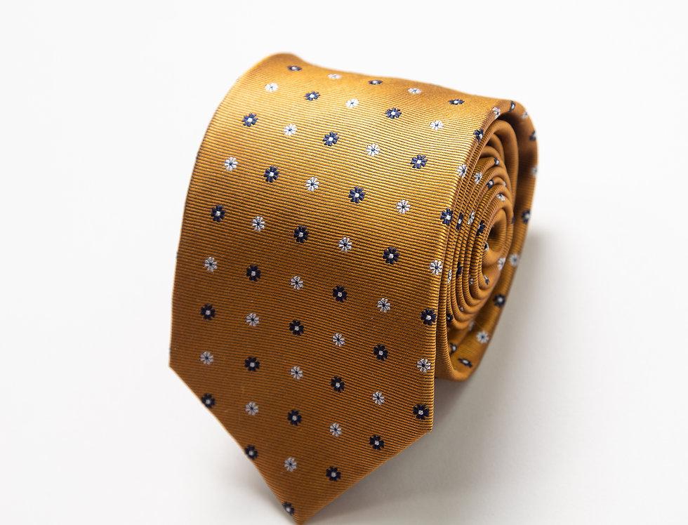 Cravatta pura seta senape con piccoli fiori blu