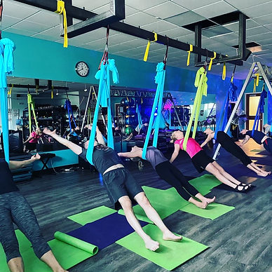 new class yoga pose with aerial hammock