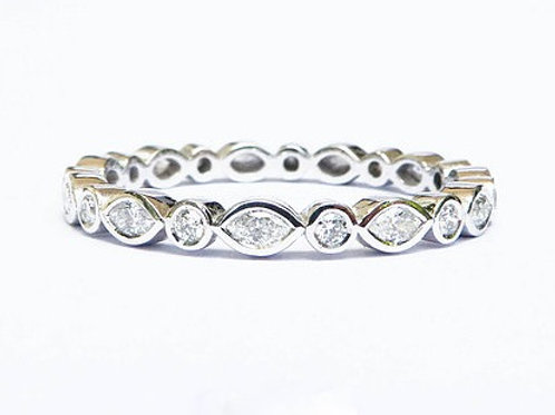 Smooth Bezel Marquise and Round Diamond Ring