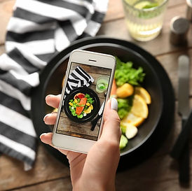 woman-taking-photo-of-diet-food-with-mob