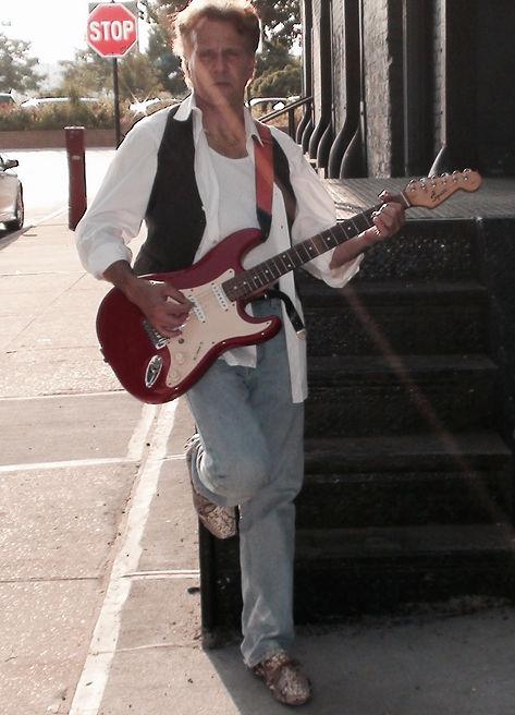 Antonio Penn posing w guitar, NYC