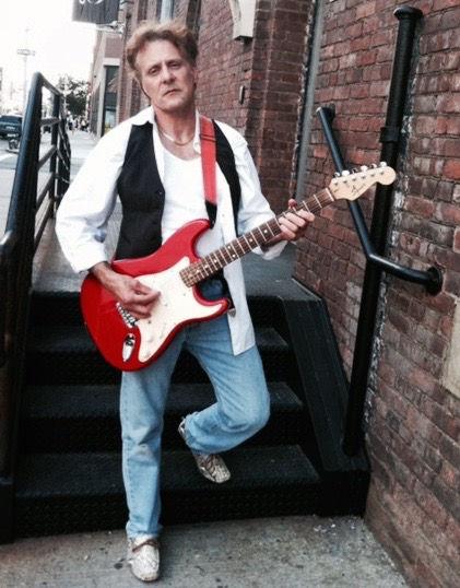 Antonio Penn posing with guitar in NYC