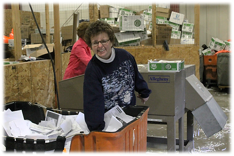 Woman working in the recycling area and smiling