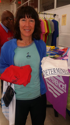 A loving and devoted mother buying shirts to encourage her daughter.