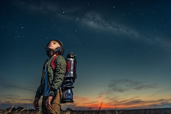 Boy with a backpack at night.jpg