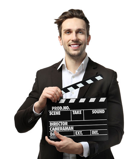Young man in a suit holding a movie clap