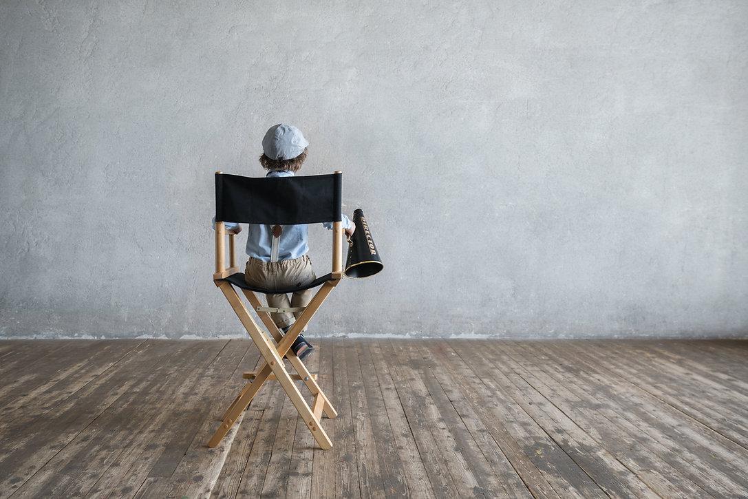 Boy on the director's chair.jpg
