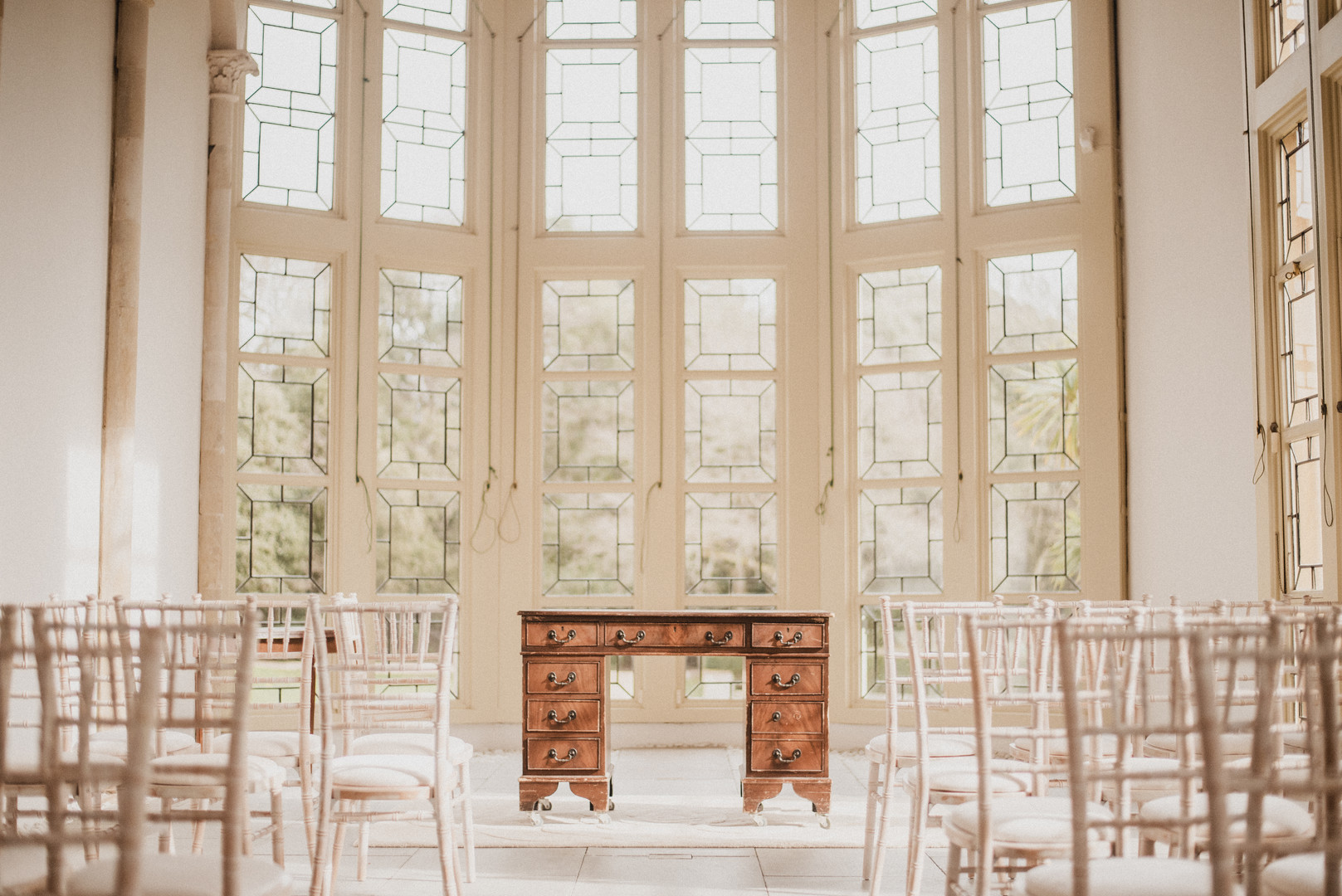 The Parlor in Highcliffe Castle is used today for weddings and other gatherings. The windows surrounding the room allow a warm, soft glow to fill the space.  Mary Kathryn Carpenter