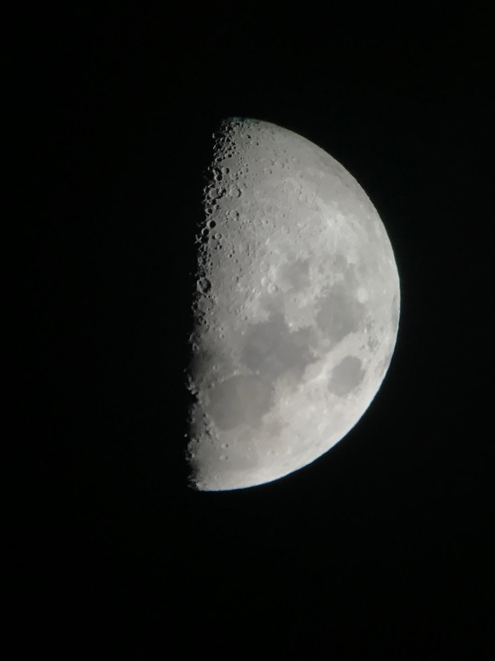 a picture of a half moon, taken by a member of our crew
