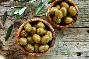Fresh olives and olive oil  on rustic wo
