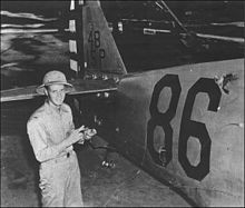 Rasmussen next to his damaged P-36