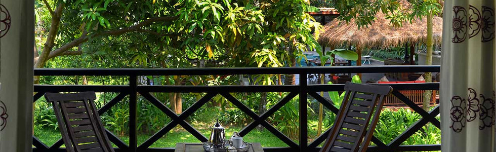 Khmer House Balcony overlooking the pool and garden dining