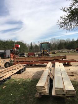 mill setup log on lumber stack.jpeg