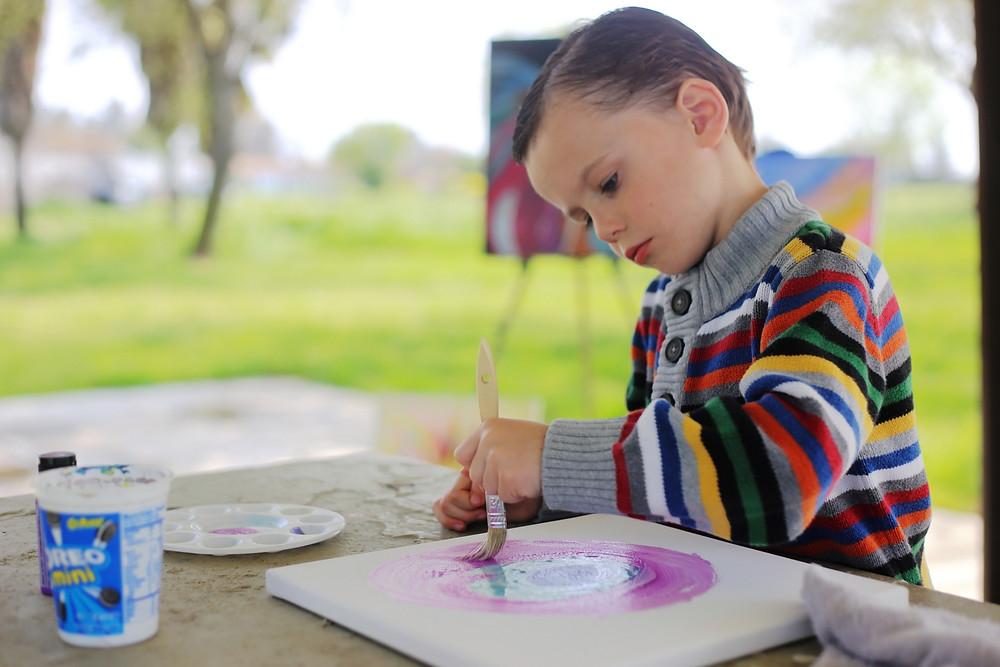 Nathaniel Pruitt Nathaniel Pruitt paints during a recent trip to a neighborhood park.