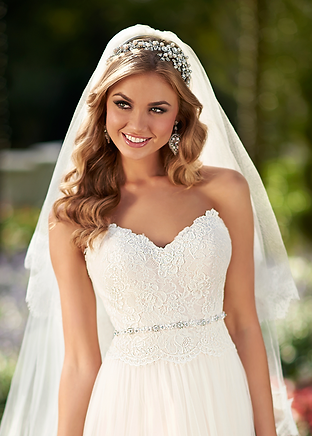 Bride in strapless wedding dress with veil and headpiece