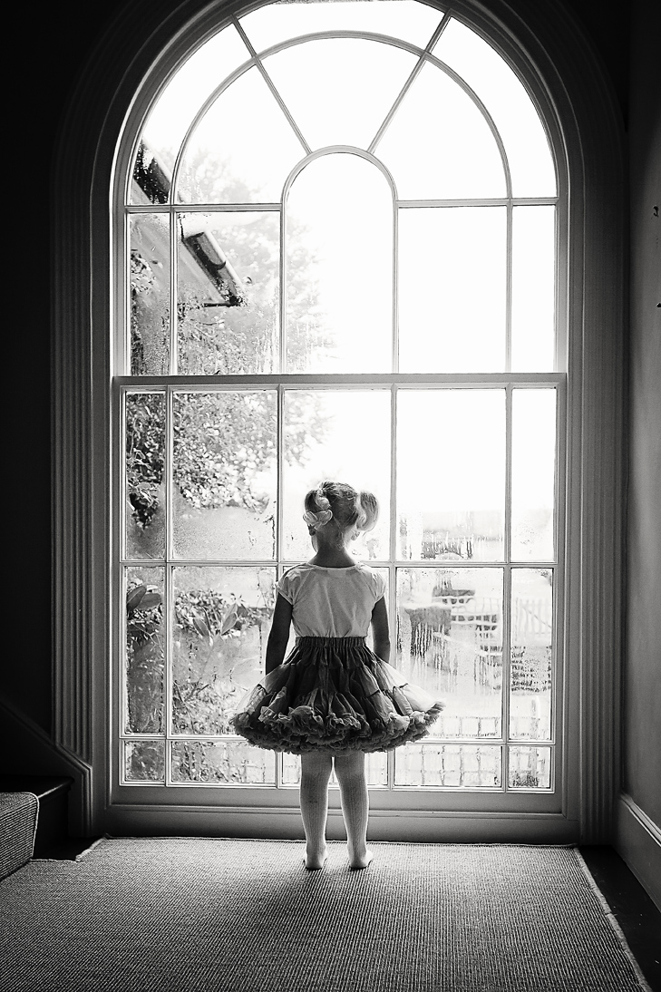 Girl by a large window