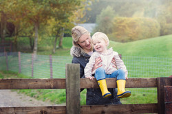 Mum and Girl Laughing on Fence