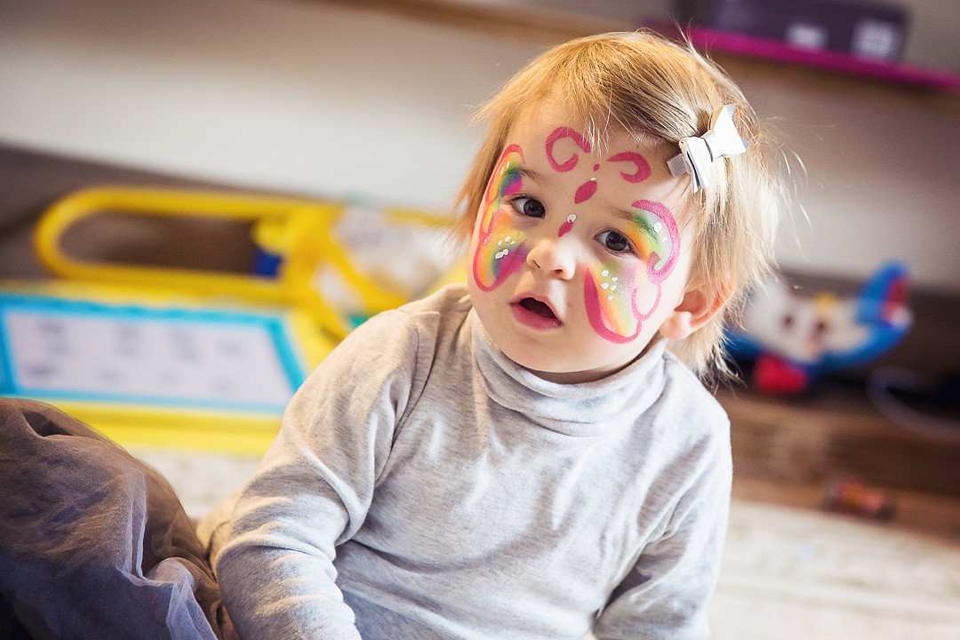 Little girl with facepaint at party