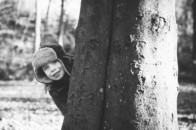 Boy behind Tree Wendover Woods