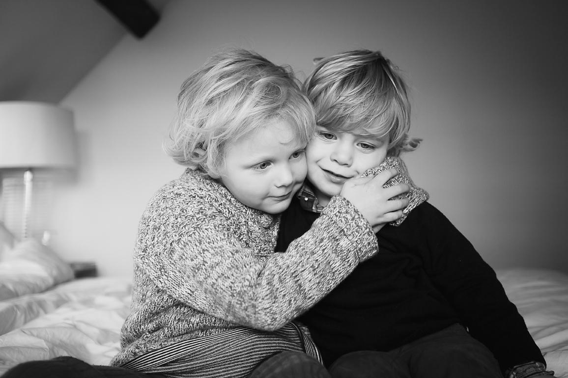 Children Hugging Black and White