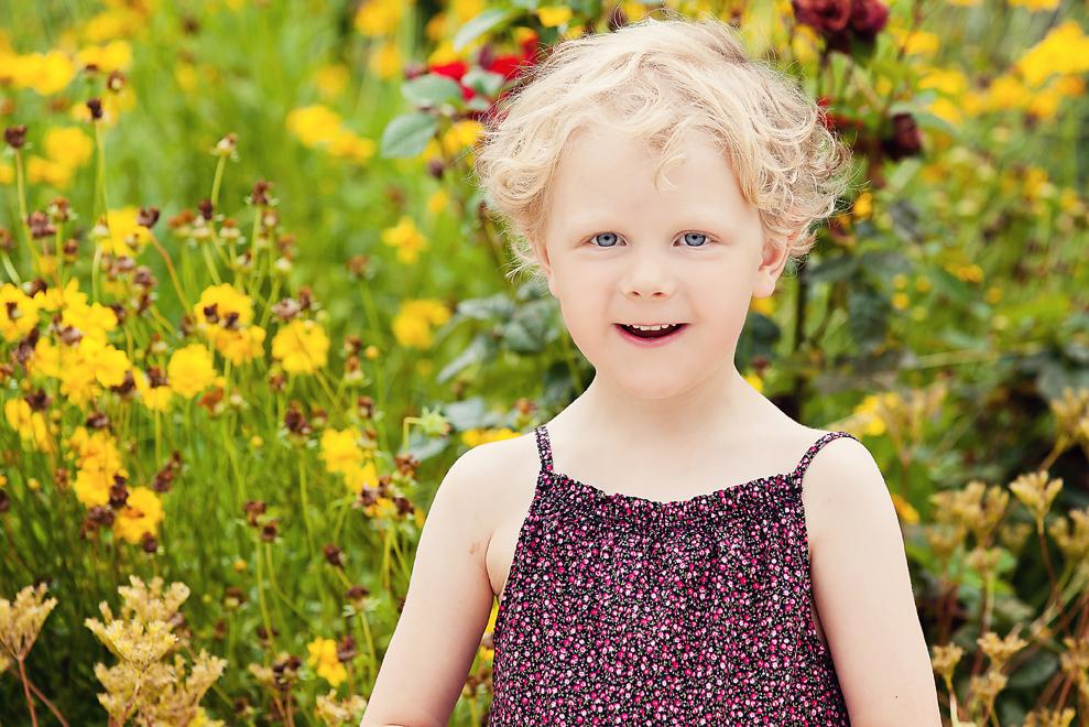 Smiling Girl near Flowers