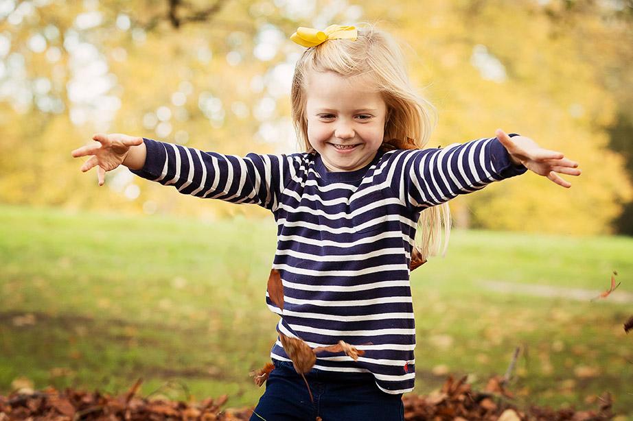 Girl throwing leaves Waddesdon Manor