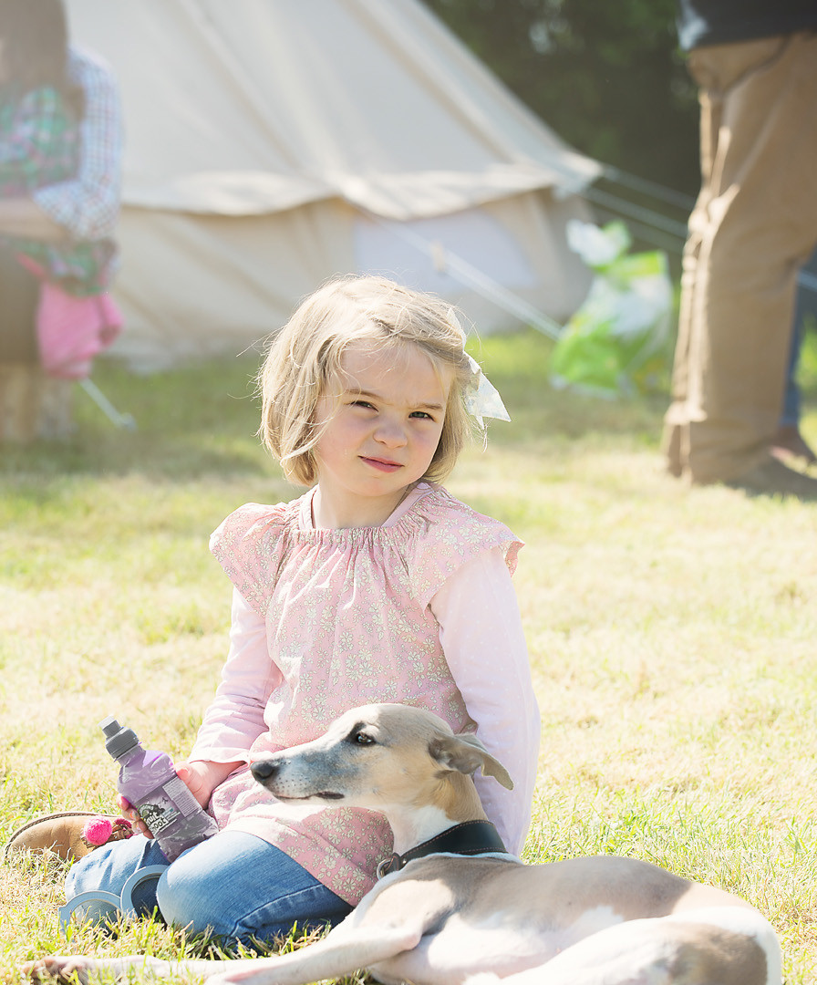 Girl with dog at summer party