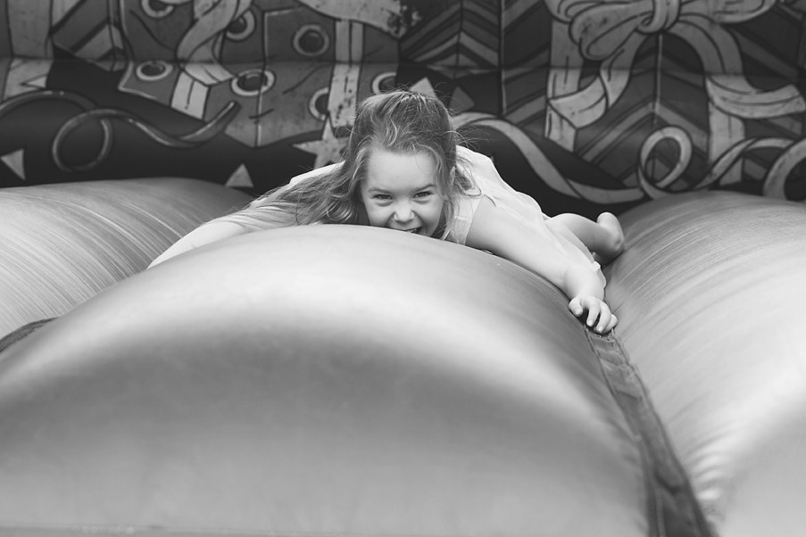 Girl laughing on a bouncy castle