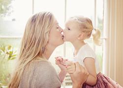 Mum and Girl kiss Suffolk