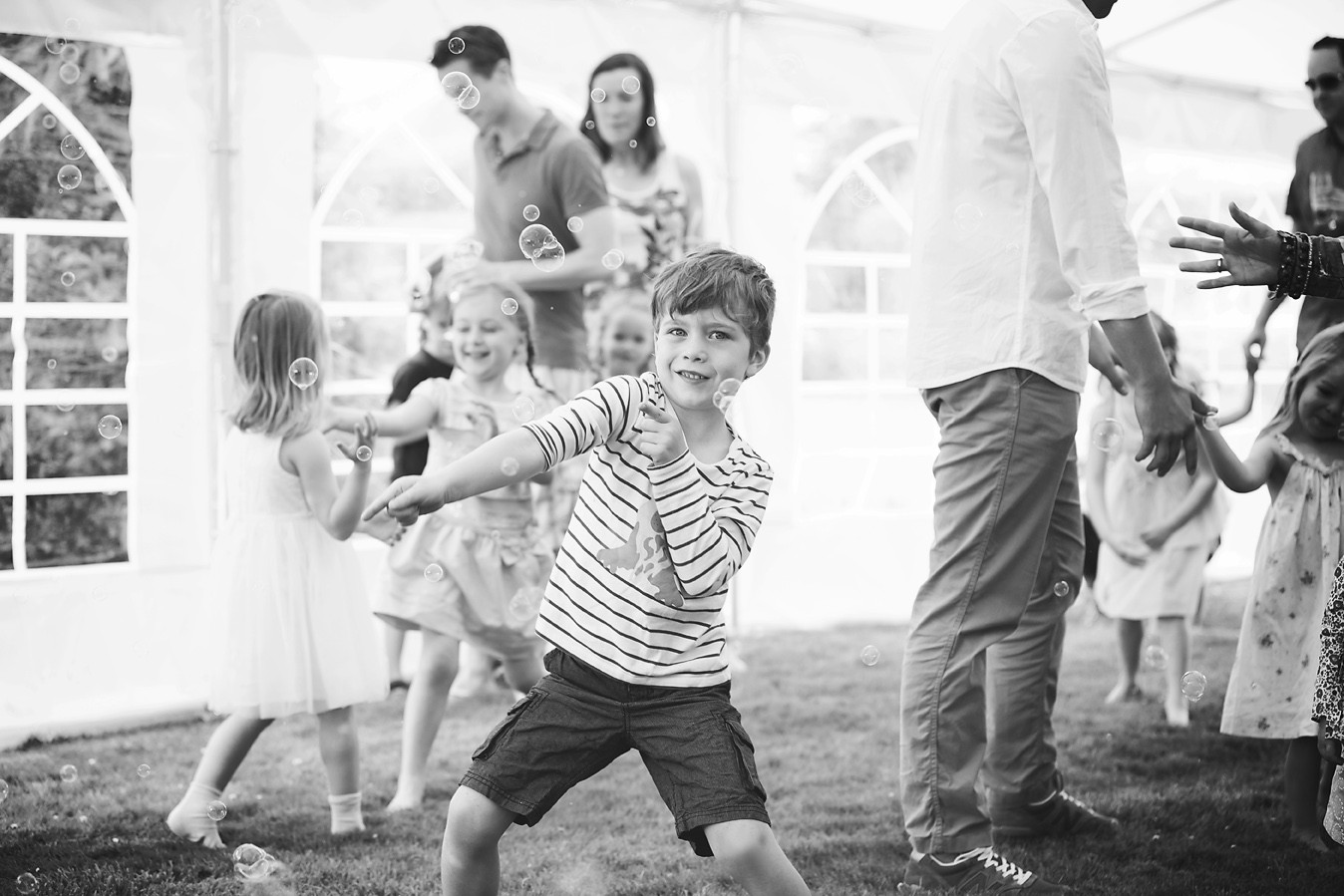 Boy Dancing at a Party in bubbles