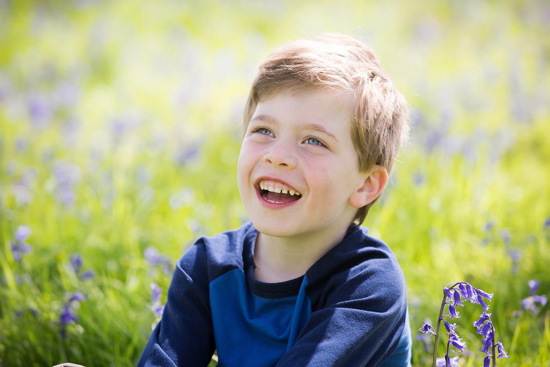 Boy sitting in Bluebells Borstall