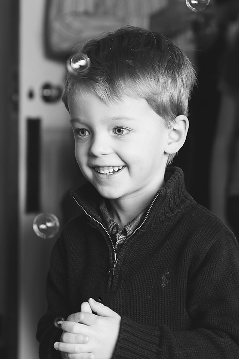 Black and White Photo boy laughing