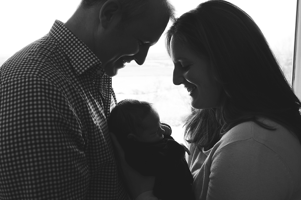 Silhouette of parents and baby