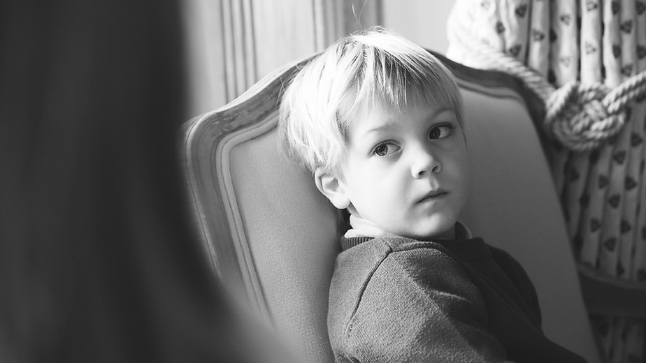 Thoughtful boy black and white