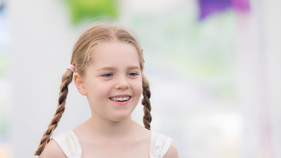 Cute girl with plaits at a party