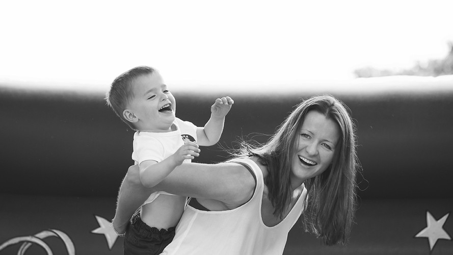 Boy and Mum on Bouncy Castle