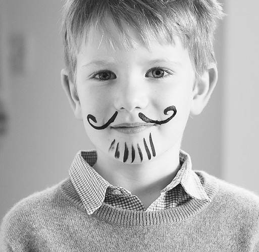Boy with facepaint at party