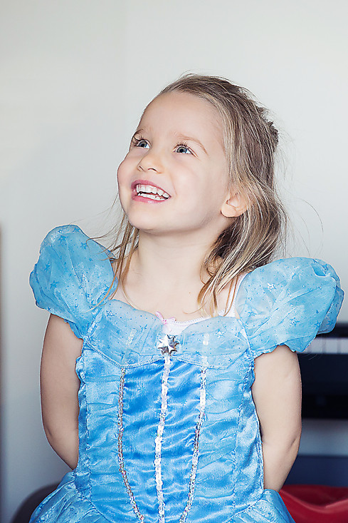 Laughing girl in press dress