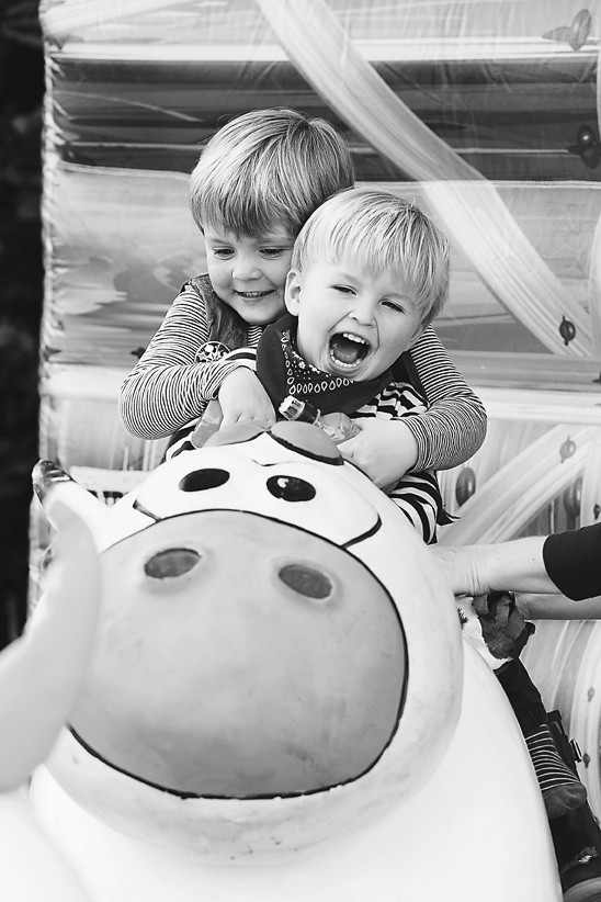 Brothers on a cow ride