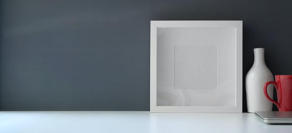 white-wooden-frame-on-white-flat-board-3